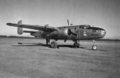 In 1942 staat in Camp Columbia te Australië deze middelzware Mitchell B-25 bommenwerper die eerder bij de ML-KNIL in gebruik was en omgebouwd werd tot een transportvliegtuig voor de Netherlands Oost-Indische Transportdienst (Netherlands East Indies Transport Service (NEITS)). De neus werd afgesloten en de koepels en de gehele bewapening werd verwijderd.