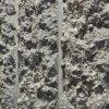 Huidige entree aan de Van Oldenbarneveltplaats. Detail van de betonnen wand.