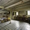 Interieur, overzicht van de oorspronkelijke keuken in het souterrain