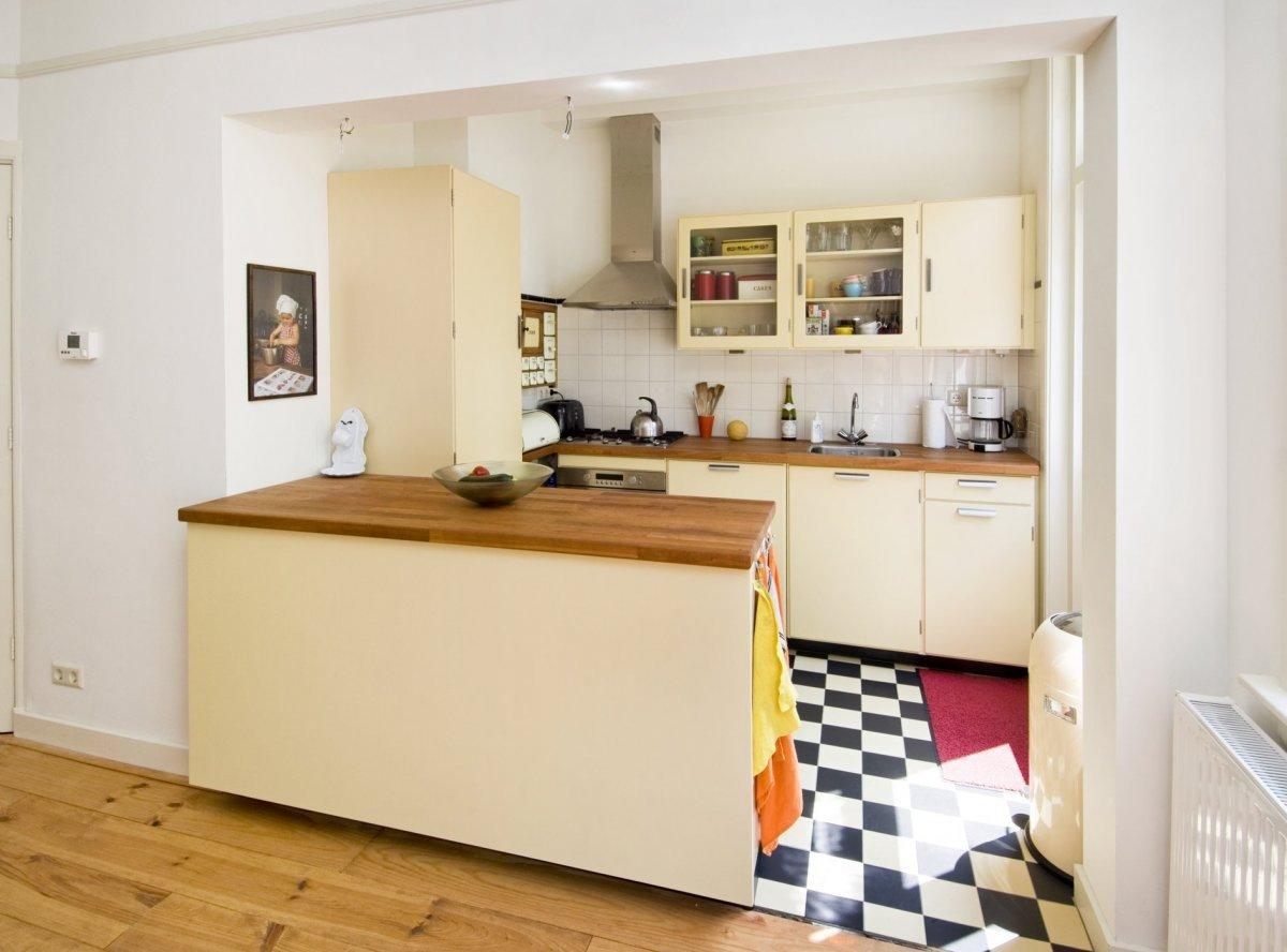 Reeks rijtjeshuizen opgetrokken in rode baksteen met twee bouwlagen en kapverdieping onder een - Hoe dicht een open keuken ...