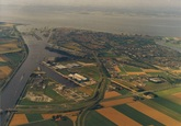 Luchtfoto van de Kanaalhavens Terneuzen met de bebouwing van de stad...