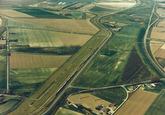 Luchtfoto Europaweg-Oost met in de verte de Quarleshaven te...