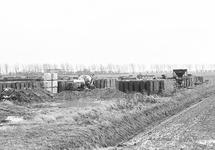 Opslag bouwmaterialen bij Fassaert beton aan de Axelse Sassing.