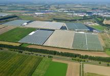 Uitbreiding kassen in het glastuinbouwgebied in de Autrichepolder. Op...