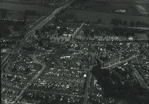 Luchtfoto Sas van Gent met kanaal en brug op de achtergrond.