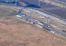 Luchtfoto sporen aan de Europaweg-Oost met de kruising van de...