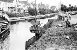 Het vernieuwen van een damwand aan Zijkanaal H te Sas van Gent.
