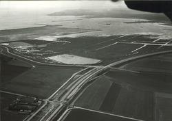 Luchtfoto baggeren Sloehaven te Vlissingen-Oost.