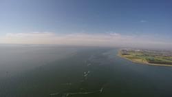 Timelaps vlucht over de haven van Vlissingen-Oost naar de Noordzee.
