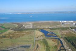 Luchtfoto Mosselbanken met natuurgebied Braakman Noord.