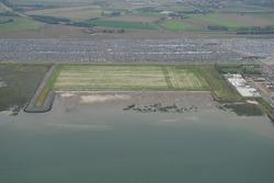 Luchtfoto recent aangelegd zanddepot aan de Ritthemsestraat met zand...