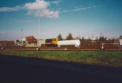 Wagon en locomotief op het rangeerterrein aan de Stationsweg in...