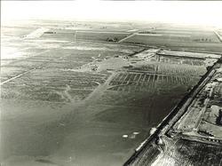 Luchtfoto van baggerwerkzaamheden in de Sloehaven te Vlissingen-Oost.