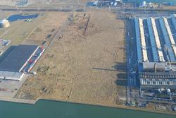 Luchtfoto braakliggende industrieterrein naast Zalco aan de...