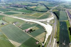 Luchtfoto terrein Sloepoort met werkzaamheden aanleg nieuwe Sloeweg.