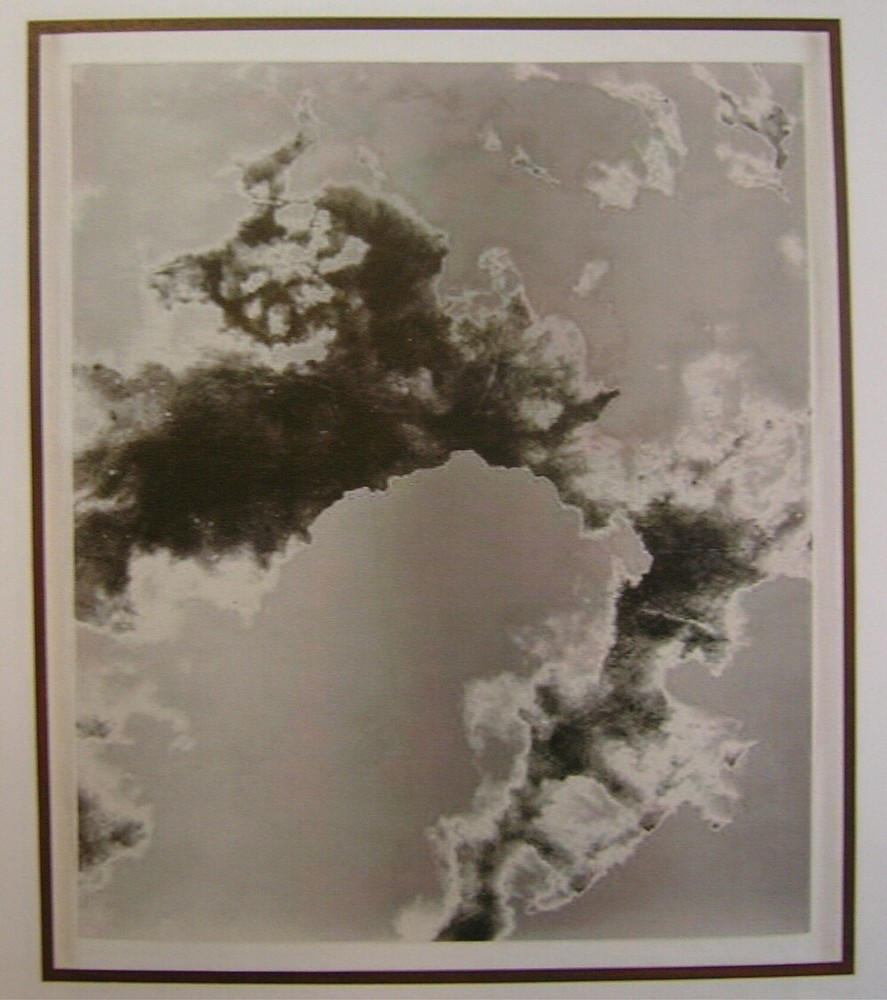 Man holding a very large camera photographing a cataclysmic event, possibly a volcano erupting 1908/2012 (Version X)