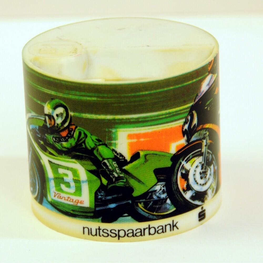 Spaarpot van de Nutsspaarbank met racemotoren erop