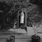 Singel 58-64, detail van de tuinmuur in de Langestraat