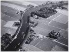 Luchtfoto in zuidoostelijke richitng van de Amstel nabij Ouderkerk aan de Amste.…