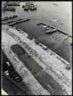 Vervallen parkeerplaatsen bij de De Ruijterkade gezien vanuit het Havengebouw, D…