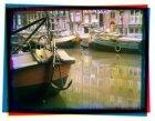Keizersgracht 35-45 en 65. Met binnenvaartschepen. Gezien vanaf de evenzijde van…