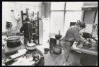 Schoonmaak in de centrale keuken van kraakcomplex Wijers aan de Nieuwezijds Voor…
