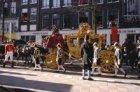 Prins Willem Alexander in de Gouden Koets rijdend over de Nieuwezijds Voorburgwa…