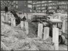 Almstraat 1-77, werkzaamheden aan de fundering van het Kepplerhuis in mei 1956