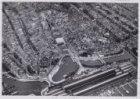 Luchtfoto met van onder naar boven: De Ruijterkade, Stationsplein, Open Havenfro…