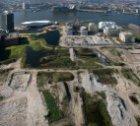 Luchtfoto van braakliggend bouwterrein op het voormalige Shell-terrein