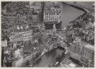 Luchtfoto van het Muntplein en omgeving gezien in noordoostelijke richting