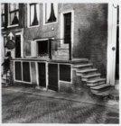 Pothuisje aan de Leidsegracht, de zijgevel van Herengracht 394