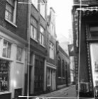 Lange Keizersdwarsstraat 4, 6, 12 en 14 v.r.n.l. met rechts aansluitend een deel…