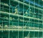 Oranje-Vrijstaatkade. Metselaars aan het werk op de bouwsteiger van het nieuwe S…