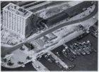 Luchtfoto van het Havengebouw, De Ruijterkade 7, gezien in zuidwestelijke richti…