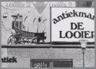 Antiekmarkt De Looier, Elandsgracht 109, met huifkar op het platte dak