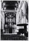 Oudekerksplein 15-17. Interieur van de Oude Kerk met gezicht op het orgel