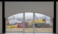 Uitzicht op een bouwterrein in het Polderweggebied vanuit de nieuwe expositierui…