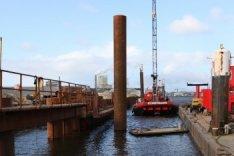 Bouwwerkzaamheden voor de bouw van nieuwbouwwoningen in de Nieuwe Houthaven