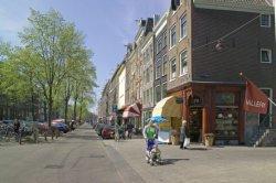 Elandsgracht 78-92 (rechts, v.r.n.l.) met rechts: hoek Hazenstraat