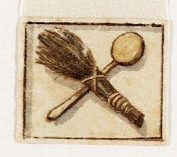 Een gevelsteen met een plak en een roe van de Latijnse School, Gravenstraat 22