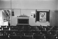Acetaatnegatief van het leslokaal in de schoolwerktuin aan de Spaarndammerdijk