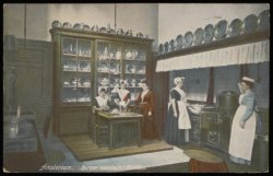 Meisjes krijgen kookles in het Burgerweeshuis, Kalverstraat 92. Uitgave N.J. Boo…