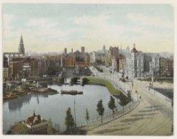 Panorama van Open Havenfront, De Ruijterkade en Damrak, gezien vanaf het dak van…