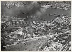 Luchtfoto van de Spaarndammerbuurt, Houthaven en Afgesloten IJ. Rechtsonder het …