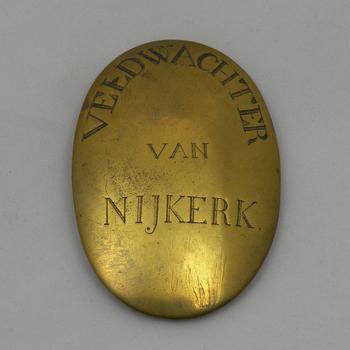Insigne met het opschrift 'Veldwachter van Nijkerk'