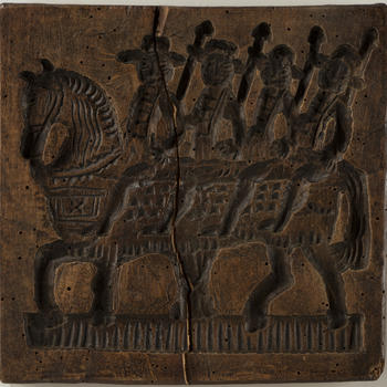 Koekplank met een voorstelling van de vier Heemskinderen