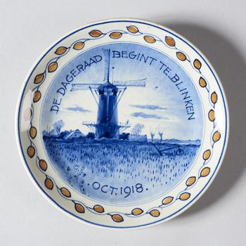 Gedenkbord 'De dageraad begint te blinken oct. 1918'