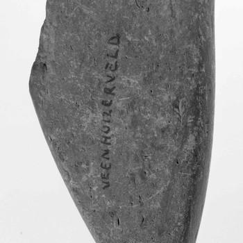 fragment van een hamer met steelgat