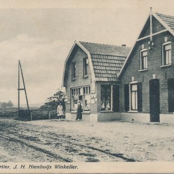 Ansichtkaart J.H. Nienhuijs voor zijn winkel te Babberich-Kwartier